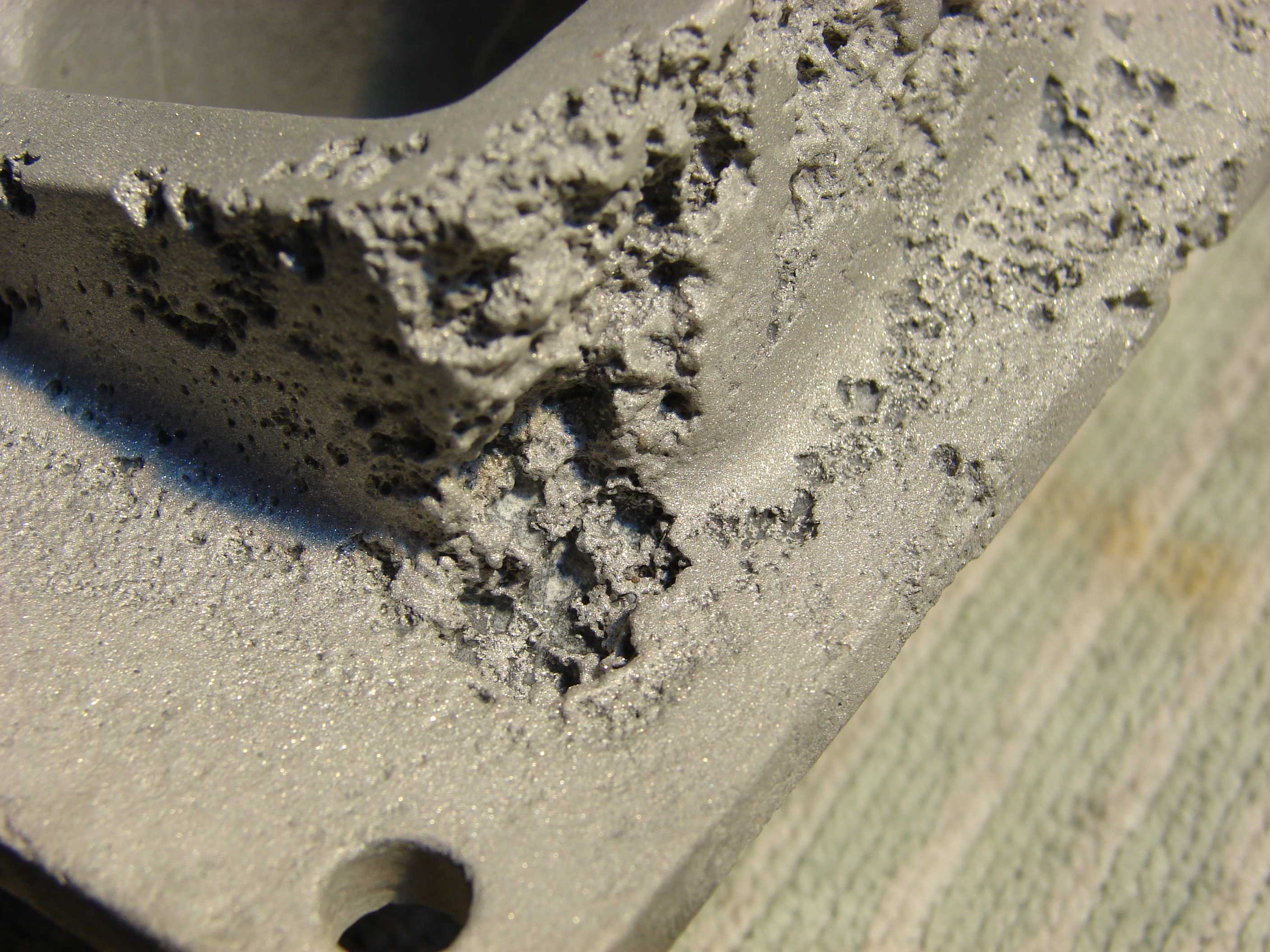 Pitting corrosion on Aluminium part